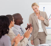 Businesswoman applauding after her presentation Stock Photos