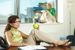 Businesswoman with apple Stock Photo