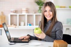 Businesswoman with apple Stock Photos