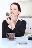Businesswoman applying lipstick Stock Photography