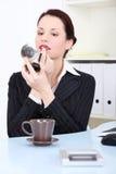 Businesswoman Applying Lipstick Stock Photography