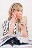 Businesswoman applying makeup Royalty Free Stock Photo