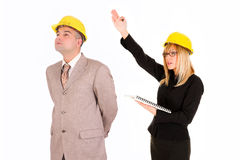 Businesswoman and architect looking up Stock Photo