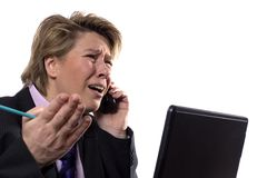 Businesswoman arguing. A businesswoman arguing with her boss over the phone stock photography