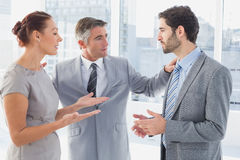 Businesswoman arguing with co-worker Royalty Free Stock Photo