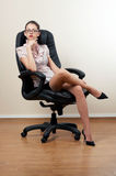 Businesswoman in armchair Royalty Free Stock Photography