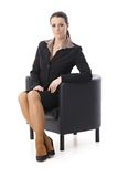 Businesswoman in armchair Royalty Free Stock Photo
