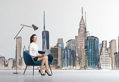 Businesswoman in armchair, city stock images