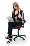 Businesswoman  in an armchair on white Royalty Free Stock Image