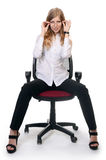 Businesswoman in an armchair  on white background Stock Photos