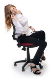 Businesswoman in an armchair on white background Stock Photo