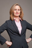 Businesswoman arms Akimbo Stock Photos