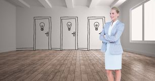 Businesswoman with arms crossed against drawn light bulbs on doors Stock Photography