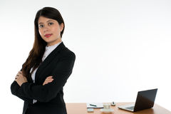 Businesswoman Arms Crossed and Smiling Royalty Free Stock Image