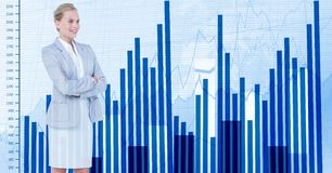 Businesswoman with arms crossed standing by graph. Digital composite of Businesswoman with arms crossed standing by graph Stock Photo