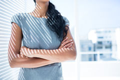 Businesswoman with arms folded in the office Royalty Free Stock Photos