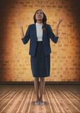 Businesswoman with arms open hopefully in room. Digital composite of Businesswoman with arms open hopefully in room Stock Image