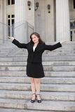 Businesswoman with arms outstretched Stock Photos