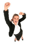 Businesswoman with arms raised. Portrait of a young businesswoman raising her hands and laughing Stock Image