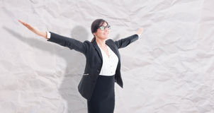 Businesswoman with arms raised outstretched Royalty Free Stock Photography