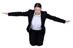 Businesswoman with arms stretched Royalty Free Stock Images