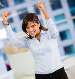 Businesswoman with arms up Stock Image
