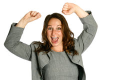 Businesswoman arms up in air. Young female businesswoman with both arms up in air showing jubilation, isolated on white stock photos