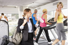 Businesswoman Arriving At Gym After Work stock photos