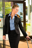 Businesswoman arriving at Hotel Royalty Free Stock Photos