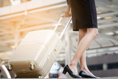 Businesswoman arriving at hotel with her suitcases Stock Photography