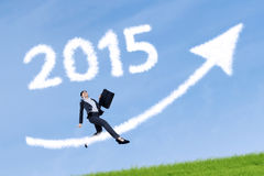 Businesswoman with arrow and number 2015 Stock Photos