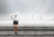 Businesswoman with arrow Royalty Free Stock Photography