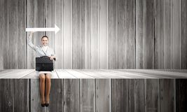 Businesswoman with arrow Stock Images