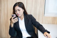 Businesswoman asian using phone for celling and texting on her mobile phone stock image