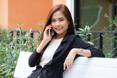 Businesswoman asian using phone for celling and texting on her mobile phone royalty free stock photography