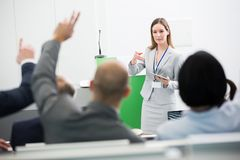 Businesswoman Asking Questions To Audience While Holding Digital Tablet royalty free stock image