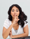 Businesswoman asking for silence Stock Photo