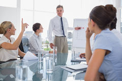 Businesswoman asking something during a meeting Stock Image