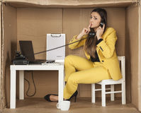 Businesswoman asks for silence during a telephone conversation. Business woman asks for silence during a telephone conversation Stock Photo