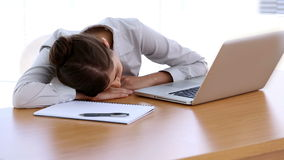 Businesswoman asleep on her desk stock footage