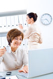 Businesswoman and assistant royalty free stock photography