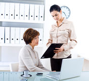 Businesswoman and assistant Stock Photography