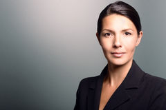 Businesswoman with an attentive expression Royalty Free Stock Photo