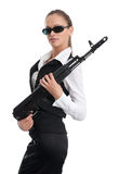 Businesswoman with a automatic rifle Stock Photos
