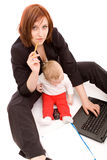Businesswoman with baby Stock Photography
