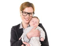 Businesswoman with baby in her arms Stock Photos