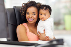 Businesswoman baby office Stock Image