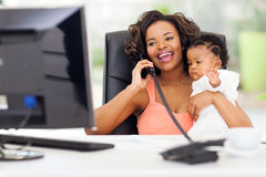 Businesswoman baby office Royalty Free Stock Photos