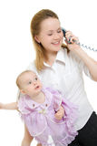 Businesswoman with a baby on the phone Stock Images