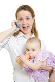 Businesswoman with a baby on the phone Stock Photography